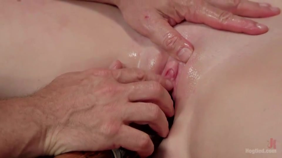 Tied to the bed and screaming because of a giant dildo in her tight pussy