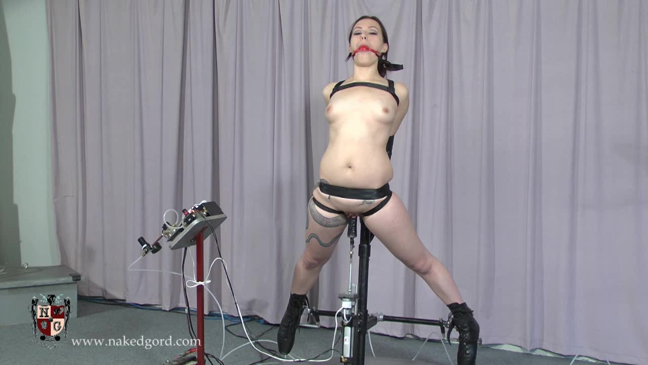 Naked slave gets tortured with a big mechanical dildo